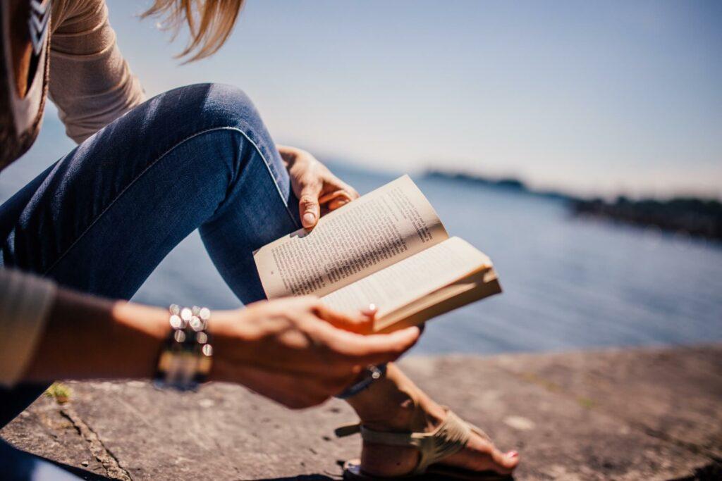Woman reading on the shoreline