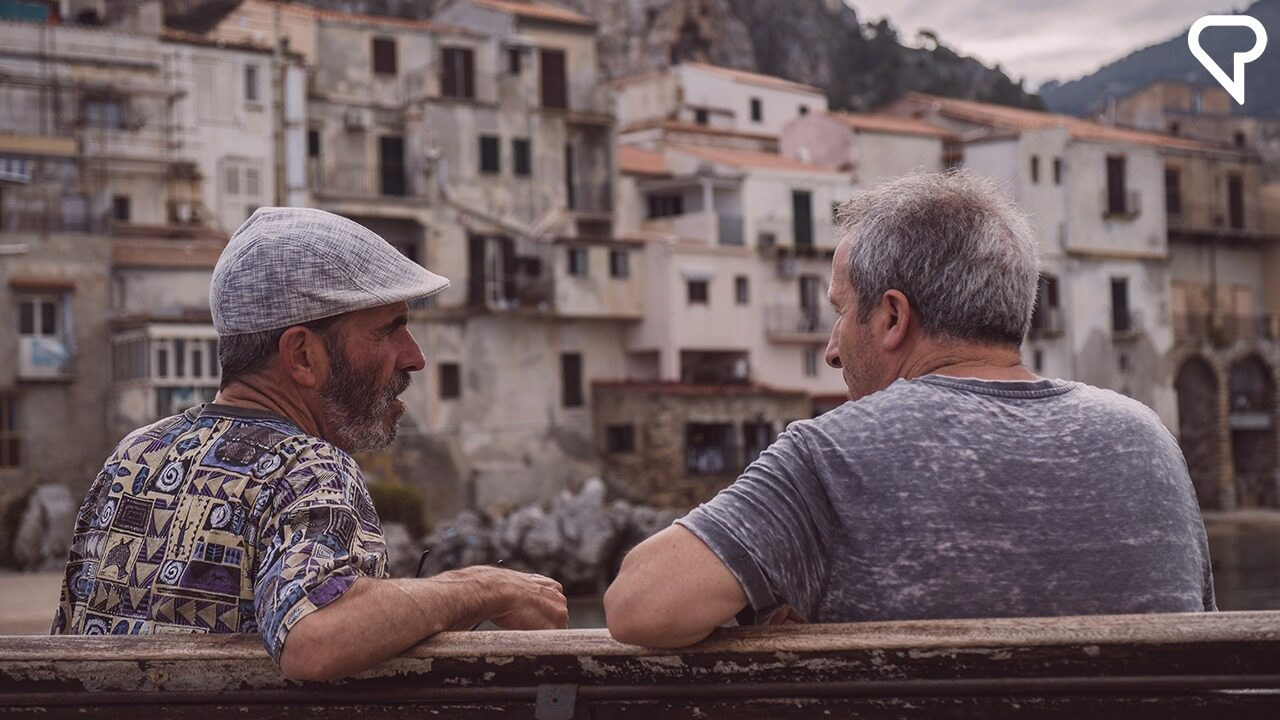 Two Italian men talking outside