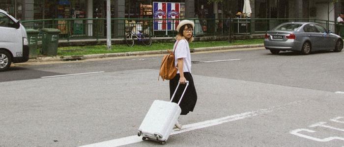 korean girl carrying luggage