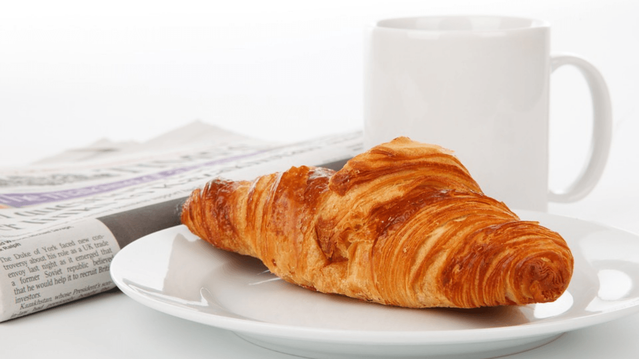 Newspaper and Croissant